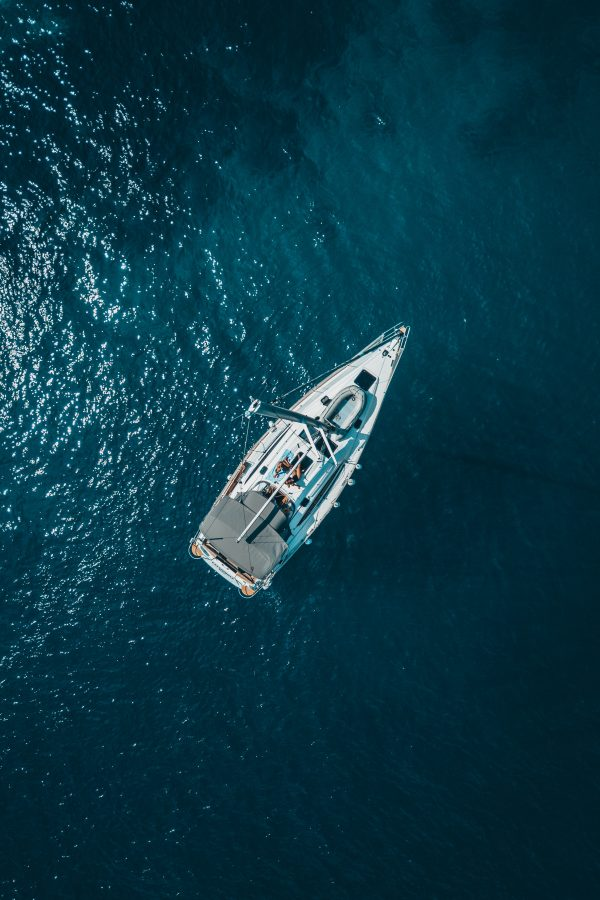 high-angle-photo-of-white-boat-on-body-of-water-1295036